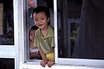 Brunei;Bruneian;Borneo;Southest_Asia;Asia;boy;boys;child;children;youngsters;kids;childhood;person;people;boys;childhood;children;kids;people;persons;youngsters;Bandar_Seri_Begawan;Brunei_Darussalam;Little;boy;looking;window;Kampung;Ayer;village