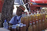 Martinique;Martiniquais;Martinican;Saint_Pierre;Antilles;beverages;Caribbean;drinking;drinks;female;foods;juices;man;men;male;person;people;people;person;persons;tropical;West_Indies;woman;women;Juice;preserves;vendor