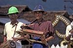Burma;Myanmar;Burmese;Myanmarese;Asia;Southeast_Asia_;artists;entertainers;male;man;men;musicians;people;performers;performing_arts;person;persons;people;Kyaiktiyo;Men;playing;musical;instruments