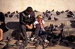 Portugal;Portuguese;Europe;Europa;birds;boy;fauna;feeing;Lisbon;Lisboa;male;man;Man;men;ornithology;people;person;persons;pigeons;animals