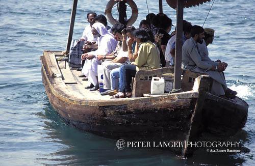 United Arab Emirates;UAE;U.A.E.;Emirati;Emirian;Arabian;Arabia ;abra;boat;boats;crowds;Dubai;Dubai Creek;Emiratis;groups;male;man;men;Middle East;Near East;people;Arabs;Arabians;Arabic;people;Arabs;Arabians;Arabic;person;persons;transportation;vessels;Arabian Peninsula