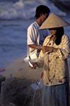 Vietnam;Vietnamese;Asia;Indochina;Southeast_Asia;female;fisherman;fishermen;fishing_industry;people;person;persons;people;woman;women;Phan_Thiet;Binh_Thuan;Woman;removing;fish;net;Mui_Na;Beach